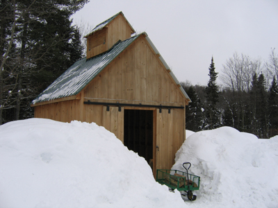 woodshed with firewood provided